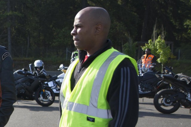 Sgt. Kerry Keels, 7th Infantry Division, listens to a safety briefing before participating in a division motorcycle safety ride, May 22.