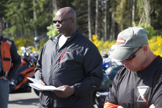 Master Sgt. Dewayne Darling (center), 7th Infantry Division, gives a safety briefing before participating in a division motorcycle safety ride, May 22. The ride is part of a program to promote safe riding practices, improve rider skills and build unit camaraderie.