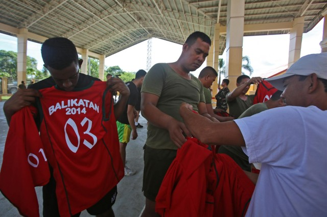 Philippine and U.S. soldiers pick out jerseys as they prepare to play in a basketball tournament between Philippine and U.S. soldiers May 5 in Palayan City, Philippines, as part of Balikatan 2014, a bilateral training exercise between Philippine and U.S. service members . Balikatan is designed to improve cooperation and interoperability between the two nations' armed forces through training, as well as humanitarian aid and disaster relief projects. Activities such as the basketball tournament allow for increased cohesion between Philippine and U.S. forces. Philippine soldiers are assigne to the 20th Infantry Battalion, 8th Infantry Division, and U.S. soldiers are assigned to the 25th Infantry Division. (U.S. Marine Corps photo by Lance Cpl. Shaltiel Dominguez)