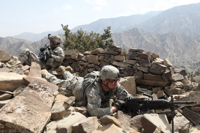 Soldiers from the 10st Airborne Division take defensive positions during a 2011 operation in Afghanistan's Barwala Kalay valley. The nine-day conflict is part of the new documentary The Hornet's Nest, which depicts the experiences of Mike and Carlos Boettcher while the father and son served as war correspondents.