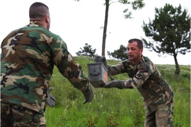 A Kosovo Security Force non-commissioned officer throws an ammo can during a Leadership Reaction Course at the Kosovo Security Force Training and Doctrine Command compound in Ferizaj, , May 29, 2014. This training exercise was the first LRC the KSF have participated in.