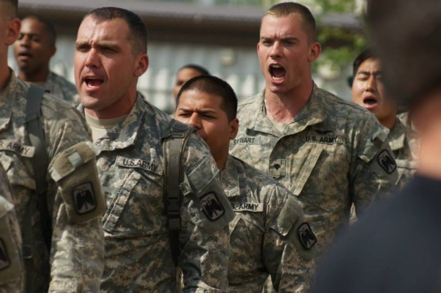 "Soldiers  from the 4th Attack Reconnaissance Squadron, 6th Calvary Regiment, 2nd Combat Aviation Brigade, 2nd Infantry Division, recite the ""Fiddler's Green,"" a traditional Calvary poem as a part of a Spur Ride, May 20, Camp Humphreys, South Korea. The Spur Ride is a physically grueling gauntlet of challenges Calvary Soldiers go through, to earn the right to wear spurs on their boots. (U.S. Army photo by Sgt. Michael Farr/ 4-6ARS Public Affairs/Released)"