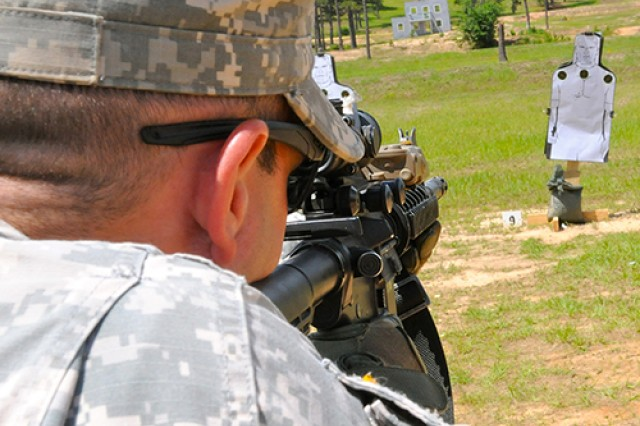 Sgt. Justin Lewis looks through his Advanced Combat Optical Gunsight during the Rifle Marksmanship Instructor Course on May 22 at the Joint Readiness Training Center, Fort Polk, La. Lewis, assigned to A Company, 2nd Battalion, 4th Infantry Regiment, 4th Brigade Combat Team, 10th Mountain Division (LI), was one of 33 leaders who completed this RMIC iteration.