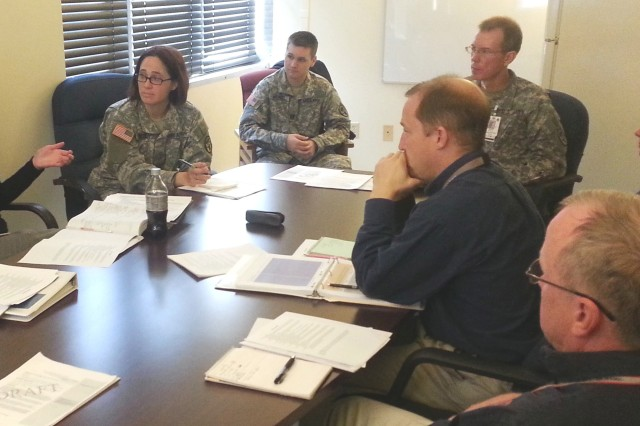 Lauren Shirey, a U.S. Army Public Health Command program evaluator, meets with the Irwin Army Community Hospital Department of Public Health accreditation team to discuss the accreditation process.