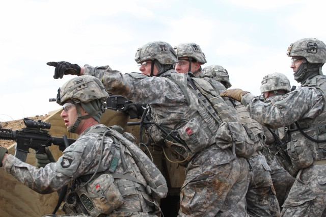 Soldiers from the 3rd BCT, 101st Airborne Division (Air Assault) equipped with Rifleman Radios execute a training mission at Fort Campbell, Ky., in March. The Army's newest radios rely on waveforms that provide secure wireless networking services for mobile and stationary forces.