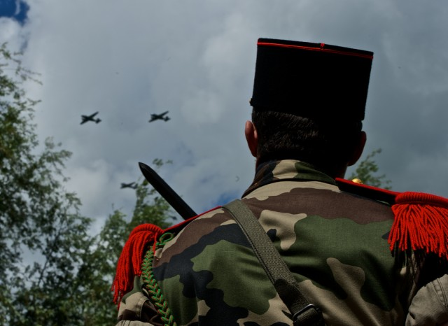 French Soldier watches Cole Monument flyover