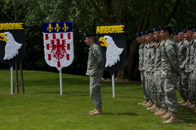 Soldiers of the 101st Airborne Division (Air Assault), gather in formation before the unveiling of the Lt. Col. Robert G. Cole monument, June 4, 2014, in Carentan, France. Cole posthumously received the Medal of Honor for his valorous man-to-man bayonet attack near Carentan. The monument serves as a visible reminder of his contributions to the town's liberation.