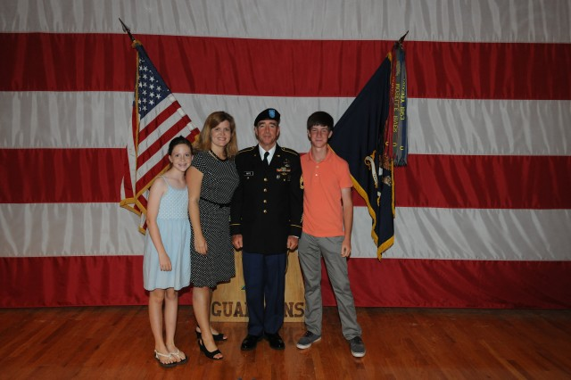Sgt. 1st Class John Taffe poses with his family after graduation from BCT. From left are McKenzie Taffe, Courtney Shepler and Owen Taffe.
