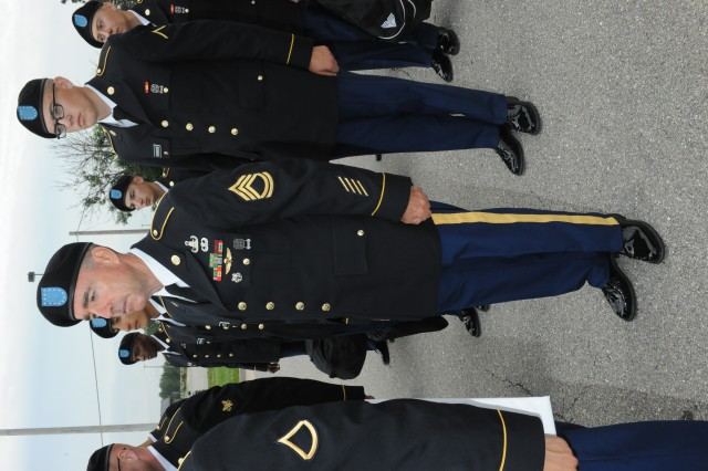 Sgt. 1st Class John Taffe stands with fellow Soldiers before entering Baker Theater for BCT graduation May 29.