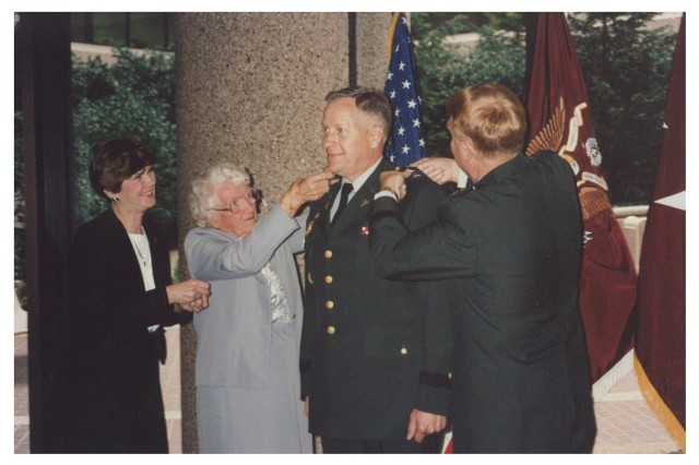 The promotion ceremony of Brig. Gen. (P) Thomas R. Tempel Sr. on Dec. 1, 1990. Attending was his son Rob (Tempel Jr.), who graduated from Gettysburg College in 1987 as Distinguished Military Graduate. Also attending was Tom's mother Ruth (second from left), his wife Elaine (far left) and their two other children, Carl and Kim.