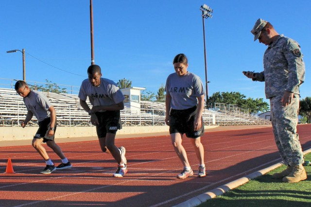 From left, Sgt. 1st Class Luis Osejo, Company A, 344th Military Intelligence Battalion; Sgt. 1st Class Charles Sheffield, Company B, 309th MI Bn.; and Sgt. 1st Class Denise Ferniza, Company A, 305th MI Bn., run laps around the track at Bujalski Field as they are timed by Sgt. 1st Class Gary Correia, Headquarters and Headquarters Company, 111th Military Intelligence Brigade. This challenge was part of the Amy Physical Fitness Test, a required event of the brigade's Platoon Sergeant of the Year Competition.