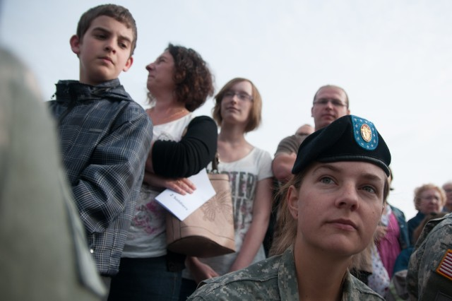 Spc. Jessika Hurst, with the Commanding General's Mounted Color Guard, 1st Infantry Division, is briefed on the evening's curfew while the Folloit family stands behind her, June 4, 2014, in Carentan, France. The family hosted Hurst and three other Soldiers at their home in Carentan with the hopes of learning more about Soldiers and to thank them for their grandfathers liberating their city 70 years ago. More than 20 Soldiers from the 1st Infantry Division's 4th Infantry Brigade Combat Team, and Commanding General's Mounted Color Guard, are in France to help commemorate the 70th anniversary of D-Day in Normandy.