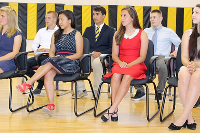 Eight Vicenza High School seniors who have elected to pursue military careers upon graduation listen to remarks during the school's first ever MIlitary Recognition ceremony May 27. Eight students out of a graduating class of more than 80 were recognized for their decisions to either enlist directly upon graduation, accept an ROTC scholarship for post-secondary education, or for receiving an appointment to one of the nation's military academies.