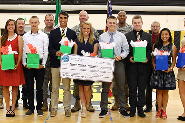Eight Vicenza High School seniors who have elected to pursue military careers upon graduation pose for a group photo after the school's first ever MIlitary Recognition ceremony May 27. Eight students out of a graduating class of more than 80 were recognized for their decisions to either enlist directly upon graduation, accept an ROTC scholarship for post-secondary education, or for receiving an appointment to one of the nation's military academies.