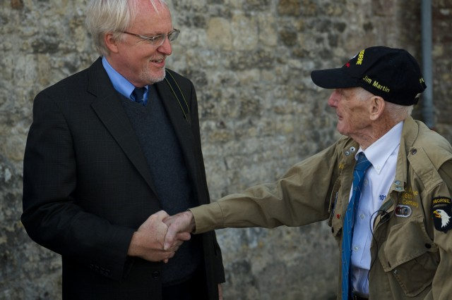 "James ""Pee Wee"" Martin, right, greets John Beyrle before a memorial ceremony for Beyrle's father, June 5, 2014, in Saint-Côme-Du-Mont, France. Martin, 93, served in the same unit as Jospeh Beyrle on D-Day, June 6, 1944, and attended the ceremony to commemorate his fellow 506th Parachute Infantry Regiment, 101st Airborne Division veteran."
