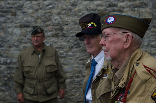 "James ""Pee Wee"" Martin, at center, and Donald R. Burgett attend a memorial ceremony for Joseph ""Jumpin' Joe"" Beyrle, June 5, 2014, in Saint-Côme-Du-Mont, France. Martin and Burgett served in the same unit as Beyrle on D-Day, June 6, 1944, and honored their fellow 506th Parachute Infantry Regiment, 101st Airborne Division comrade, on the 70th anniversary of the liberation of Normandy."