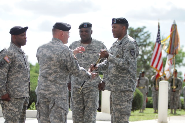 Command Sgt. Maj. Dwight Morrisey passes a saber to Maj. Gen. Mark McDonald during his retreat ceremony May 30 in front of McNair Hall. Morrisey retired after 35 years in the Army. His successor, CSM Brian Lindsey is returning as the Fires Center of Excellence and Fort Sill CSM.