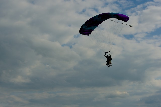 "James ""Pee Wee"" Martin approaches for a final landing with tandem jump partner Dominic Kervestin, June 5, 2014, near Utah Beach, France. Martin is 93, and has completed a final parachute jump on the occasion of the 70th anniversary of the D-Day invasion of occupied France."