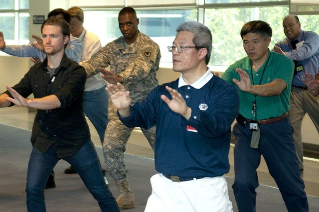 Dr. Jianping Mao demonstrates Tai Chi poses for Army Research Laboratory workforce participants. The meditation enables practitioners to achieve focus and centering.