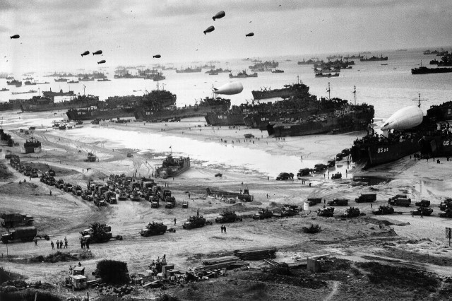 Barrage balloons float over Omaha beach in Normandy, France, June 6, 1944.
