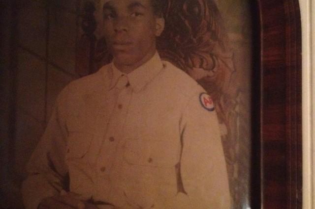 A portrait photo taken of Arthur Guest in his Army uniform.