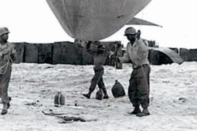 Soldiers of the African-American 320th Very Low Altitude Battalion prepare a barrage balloon for launch on Omaha Beach in Normandy, France, during D-Day, June 6, 1944.