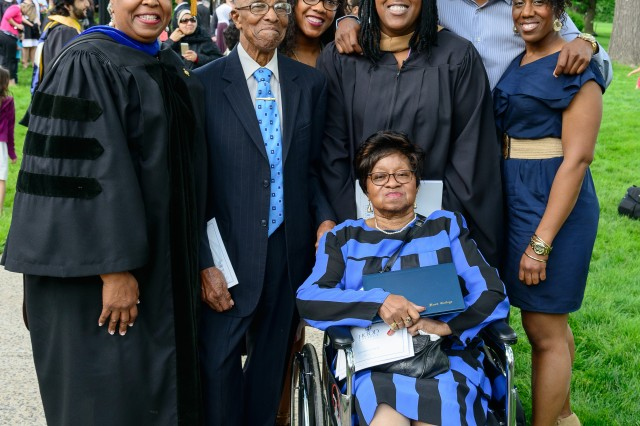Arthur Guest stands beside his wife Marthena (in wheelchair) May 17, 2014, at Hood College, Md. They were there for the graduation of his granddaughter, who earned an MBA. Another granddaughter is also in the picture, as is Arthur and his wife's daughter, Olivia White. Olivia is the vice president, Student Life & Dean of Students at Hood College.