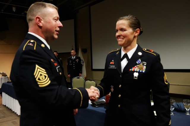 Command Sgt. Maj. Jim Wills, 80th Training Command (TASS) senior enlisted leader, congratulates Staff Sgt. Amy Justice, 7/95th Regiment, 4th Brigade, 94th Training Division, for winning the 80th Training Command (TASS) 2014 Best Warrior title at Fort Knox Ky., March 22, 2014. Justice was selected for induction into the Sergeant Audie Murphy Club following board proceedings at Fort Knox, Ky. June 6, 2014. The Sgt. Audie Murphy Club, named after the United States Military's most decorated veteran, is a private U.S. Army organization for enlisted non-commissioned officers that began at Fort Hood Texas in 1986. Candidates are formally recommended for membership based on their leadership abilities, and for showing genuine concern for Soldiers and the Soldiers' families. The competitors then appear before a panel of senior NCOs for a painstaking verbal examination.