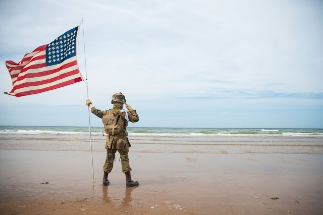 A French child, dressed as an American World War II Soldier, stands tall June 6, 2014, while saluting the sands of Omaha Beach, France. The boy, never breaking composure, stood for more than two hours during a 1st Infantry Division ceremony that helped commemorate the 70th anniversary of the D-Day landings.