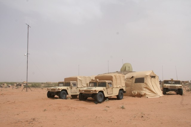 The Army's new Tactical Network Transmission equipment collection includes the new command post 4G LTE/Wi-Fi system (4G LTE/Wi-Fi antenna is seen left) and was evaluated at Army's Network Integration Evaluation 14.2, at Fort Bliss, Texas, in May 2014.