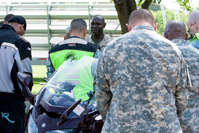 Chaplain (Lt.) Devon Foster says a blessing with the participants of a motorcycle safety ride June 4, 2014. The riders started on Joint Base Myer-Henderson Hall, drove to Marine Corps Base Quantico and returned to JBM-HH.