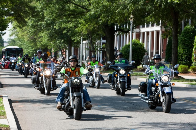 Participants in a motorcycle safety ride drive down McNair Road on their way to Marine Corps Base Quantico, June 4, 2014. The ride started on Joint Base Myer-Henderson Hall after a safety briefing.