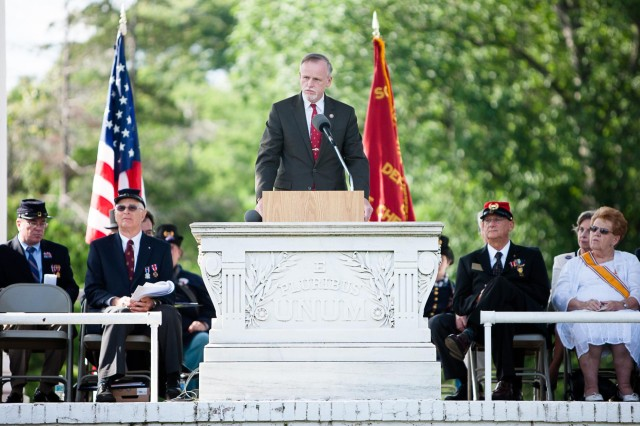 Patrick K. Hallinan, Executive director of the Army National Military Cemeteries, gives remarks during the ceremony to rename the Old Amphitheater in Arlington National Cemetery the James Tanner Amphitheater May 30, 2014.
