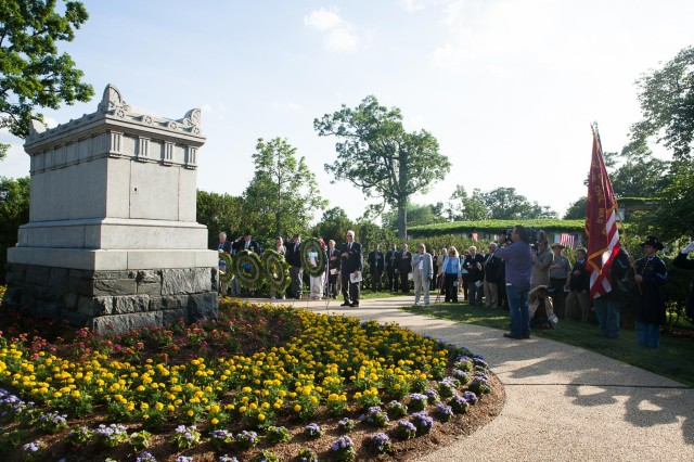 Attendees of the Sons of Union Veterans of the Civil War Decoration Day observance and renaming of the Old Amphitheater lay wreaths at the Civil War Unknowns Monument in Arlington National Cemetery, May 30, 2014. The tomb contains the remains of 2,111 Soldiers gathered from the fields of Bull Run as well as the route to the Rappahannock River according the ANC website.