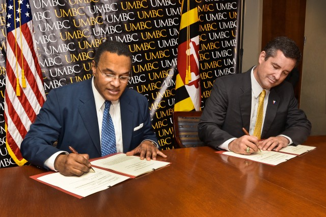 Dr. Freeman A. Hrabowski III (left), president of the University of Maryland Baltimore County, and Dale A. Ormond, director of the U.S. Army Research, Development and Engineering Command, sign a cooperative research and development agreement June 6 in Baltimore.