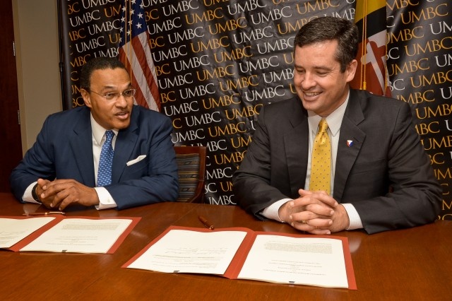 Dr. Freeman A. Hrabowski III (left), president of the University of Maryland Baltimore County, and Dale A. Ormond, director of the U.S. Army Research, Development and Engineering Command, discuss the cooperative research and development agreement June 6 in Baltimore.
