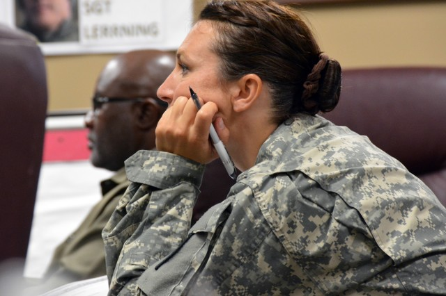 Lt. Col. Sandra Gossett listens attentively to master resilience trainer Tiz Arnold during resiliency training May 28.