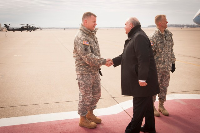 Garrison Command Sgt. Maj. Stephen Bower (left) shakes hands with Army undersecretary Joseph W. Westphal Feb. 7.