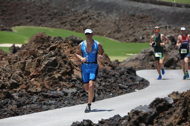 Capt. Rhett Soltas, battalion physician assistant, 3rd Battalion, 7th Field Artillery Regiment, 3rd Brigade Combat Team, 25th Infantry Division, runs through the Mauna Lani Resort golf course during the half marathon portion of the IRONMAN 70.3 Hawaii, held on the Big Island of Hawaii, May 31.