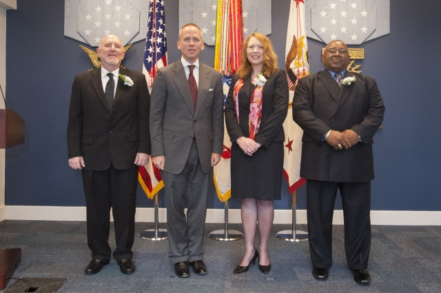 The awardees of the Kushnick, Macy, and Hoge Awards stand proudly with the Under Secretary of the Army Brad R. Carson (second from left) on June 9, 2014, during a Pentagon Hall of Heroes ceremony.  The recipients of the awards, who were chosen for their leadership and innovation, were (from left) David A. Helmer, Dianne V. Smith, and Freddie L. Giddens.