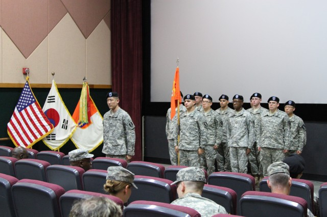 Soldiers from the 251st Signal Detachment, 1st Signal Brigade await the encasing of the detachment's guidon, signifying the deactivation at the USAG Yongsan multi-purpose training theater facility June 6, 2014. After 12 years of connecting the Korean Peninsula, the signal detachment was deactivated.