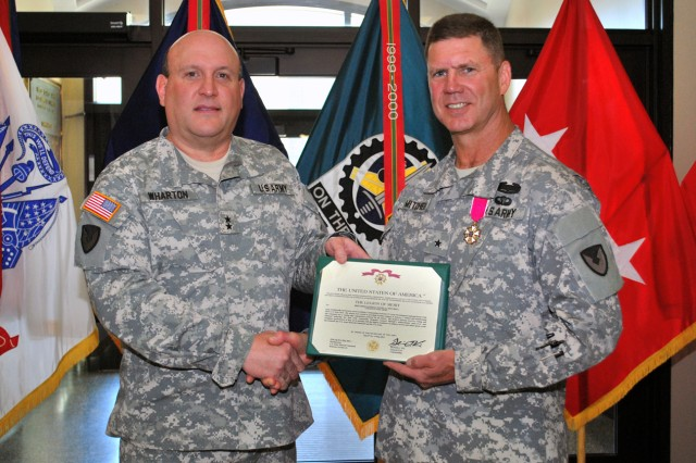 Maj. Gen.  John Wharton, commanding general of Army Sustainment Command and Rock Island Arsenal, Ill., poses with Brig. Gen. Daniel Mitchell, ASC deputy commanding general, following an award ceremony where Mitchell received the Legion of Merit for his service over the past 11 months. The ceremony was held in the ASC headquarters building at Rock Island Arsenal, June 6. Mitchell's next assignment will be deputy commanding general at 1st Theater Sustainment Command in Kuwait. (Photo by Dawn Marie Barnett, ASC Public Affairs)