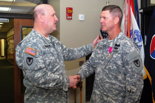 Maj. Gen.  John Wharton, commanding general of Army Sustainment Command and Rock Island Arsenal, Ill., congratulates Brig. Gen. Daniel Mitchell, ASC deputy commanding general, following an award ceremony where Mitchell received the Legion of Merit for his service over the past 11 months. The ceremony was held in the ASC headquarters building at Rock Island Arsenal, June 6. Mitchell's next assignment will be the deputy commanding general, 1st Theater Sustainment Command in Kuwait. (Photo by Dawn Marie Barnett, ASC Public Affairs)