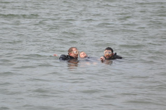 Rescue Divers Bo Dromgoole, left and Matt Powell recover Ryland Holt's body from Whitney Lake. The Whitney Middle School student was selected to portray a drowning victim as part of a water safety program created by U.S. Army Corps of Engineers park rangers to discourage cliff jumping.
