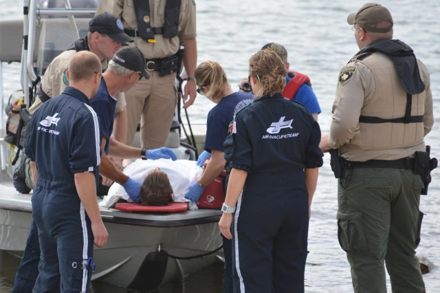 U.S. Army Corps of Engineers, Texas Fish and Wildlife Department and local Fire and Rescue and Emergency Medical Services responders simulate the recovery of a teen's body from Whitney Lake during a recent exercise. Ryland Holt, portrayed the victim as 250 of his fellow classmates and staff from Whitney Middle School looked on. Members from Air Evac Lifeteam 51, Hillsboro Fire and Rescue and the Heart of Texas Regional Advisory Council also participated in the program.