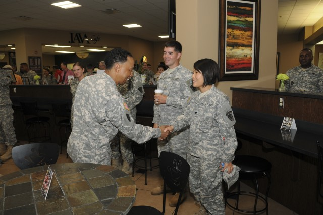 Gen. Dennis L. Via, AMC commander, shakes hands with Soldiers and civilians during Team Redstone's Army Birthday celebration. U.S. Army Photo.