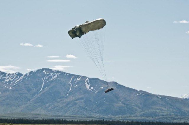 Heavy equipment dropped from an Air Force C-130 Hercules parachutes to the ground at Donnelly Training Area near Fort Greely, Alaska, June 7, 2014. The equipment was dropped for the paratroopers of 2nd Battalion, 377th Parachute Field Artillery Regiment, 4th Infantry Brigade Combat Team (Airborne), 25th Infantry Division, to allow them to provide fires support to the paratroopers of 1st Battalion (Airborne), 501st Infantry Regiment during a joint forcible entry exercise to train on airfield seizure operations and wide-area security as part of the Spartan Brigade's certification as the Army's Contingency Response Force for the Pacific Theater. (Photo by U.S. Army Sgt. Eric-James Estrada)