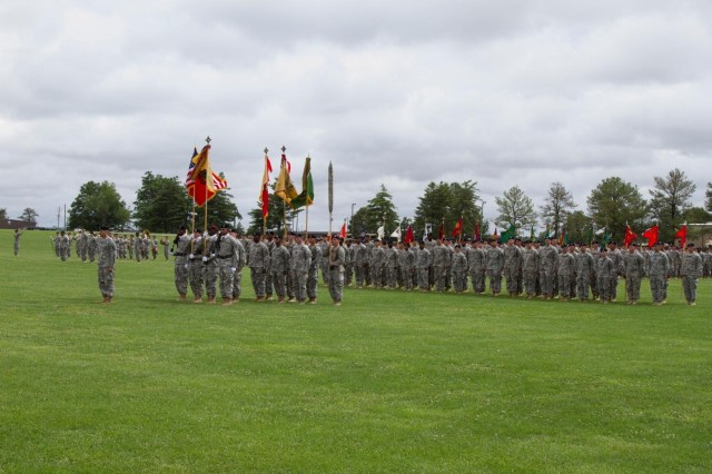 Soldiers with the 101st Sustainment Brigade, 101st Airborne Division (Air Assault), stand at attention during a change of command ceremony between Col. Charles R. Hamilton, outgoing commander of the 101st Sustainment Brigade and Col. Kimberly J. Daub, incoming commander, June 10, 2014, at Fort Campbell, Ky. The change of command signified the passing of authority and accountability of command from one leader to another. (U.S. Army photo by Sgt. Sinthia Rosario, 101st Sustainment Brigade Public Affairs)