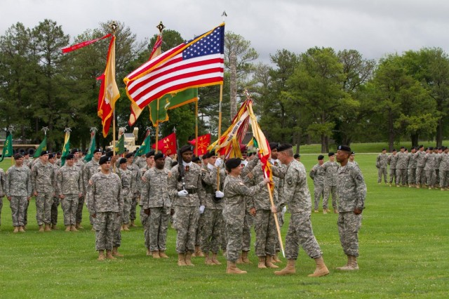 "Maj. Gen. James C. McConville (right), commanding general of the 101st Airborne Division (Air Assault), passes the unit colors to Col. Kimberly J. Daub (left), incoming commander of the 101st Sustainment Brigade ""Lifeliners,"" 101st Airborne Division (Air Assault) during a change of command ceremony, June 10, 2014, at Fort Campbell, Ky. The change of command signified the passing of authority and accountability of command from one leader to another. (U.S. Army photo by Sgt. 1st Class Mary Rose Mittlesteadt, 101st Sustainment Brigade Public Affairs)"