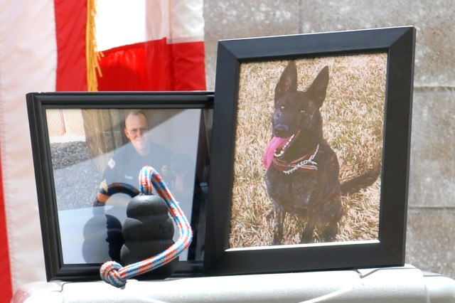 A memorial tribute shows photographs of Kyra, a military working dog that died in March, and Sgt. Jonathan Drake, Kyra's handler and police officer with Department of the Army at Fort Irwin. The May 28 memorial ceremony honored Kyra and her six years of service to Fort Irwin. Drake handled Kyra from September 2010 to her passing.